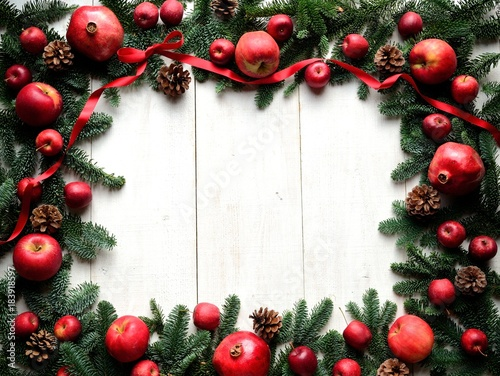 Pomegranate,apples and fir leaves.frame