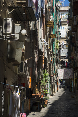 Fotobehang Napels Scenic view into the dark shadows of a narrow residential alley in the historic center (Centro Storico) of Naples, Italy