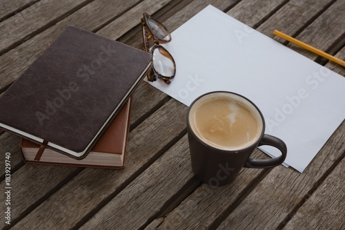 Papiers peints Cafe Organizer, coffee, spectacles, pencil and paper on wooden plank
