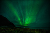 Northern lights and silhouettes of mountains.  night photo. Silhouettes of mountains. Iceland.