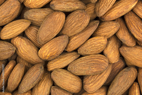 Background of scattered almond nuts closeup - 183935117