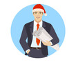 Businessman in Santa hat holding the project plans