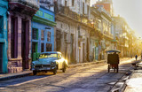 Street scene in Old Havana (La Habana Vieja), classic car, bicitaxi and people going to work, Cuba - 183953590