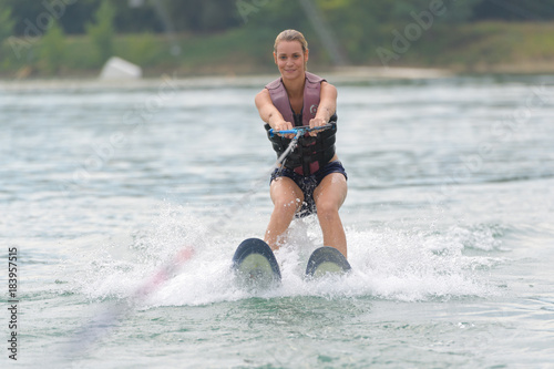 young woman doing water skiing