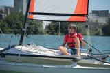mature handsome man sailing on a lake - 183963587