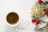 Cup of coffee and fir branch with Christmas decorations on old wooden shabby background. - 183967701