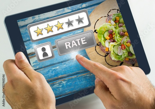 Poster Hand touching tablet with Rate button and review stars with food