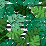 tropical palm leaves jungle leaves seamless floral pattern stripes background vector illustration - 183973301