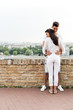 Quadro Young couple holding each other around waist
