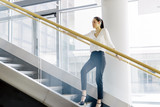 Businesswoman on stairs - 183981906