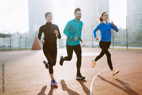 Foto op Canvas Jogging Friends fitness training together outdoors living active healthy