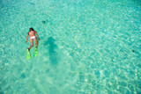 Young girl snorkeling in tropical water on vacation - 183988555