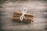 Cinnamon Sticks On A Wooden Surface - 183991940