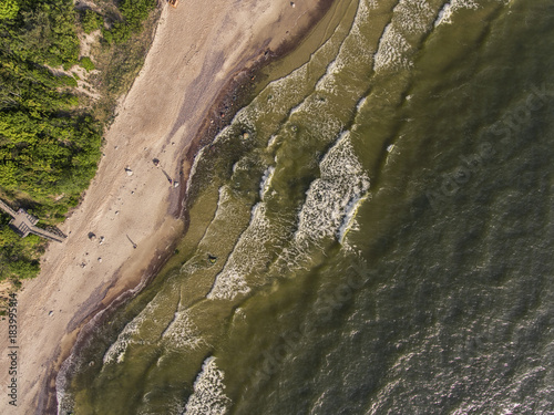 Poster Zalm Aerial view over a Baltic Sea shore line in Karkle near Klaipeda city, Lithuania. During sunny summer day.