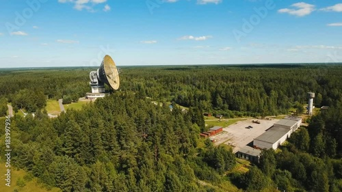 Radio astronomy observatory located in the forest. Aerial view Giant radio telescop, Large satellite dish.drone footage, 4k.