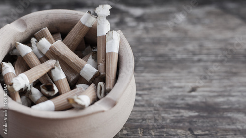 Ashtray with cigarette butts close-up
