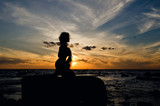 silhouette of woman at sunset - 184013510
