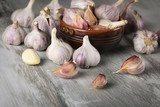 Close-up garlic bulbs and garlic cloves on wooden background - 184029323