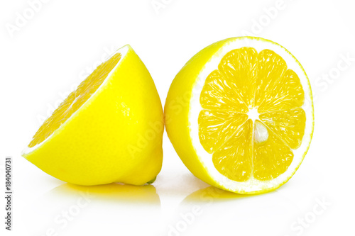 Group of ripe whole yellow lemon citrus fruit with lemon fruit half isolated on white background with clipping path - 184040731