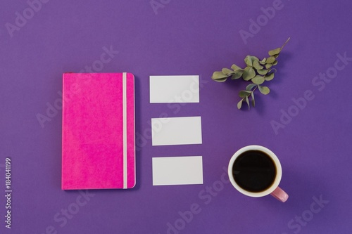 Sticker Dry leaves, file, visiting card and black coffee on purple