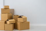 Stack of cardboard boxes in empty room - 184053373