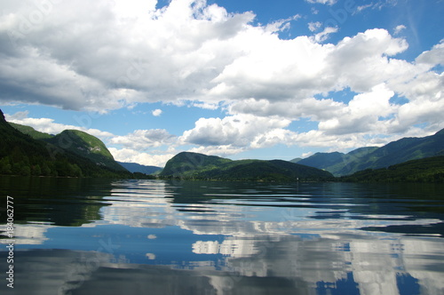 Foto op Canvas Bergen Mountain lake on sky