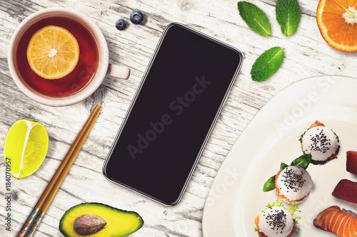 Black smartphone in a sushi bar - 184070957