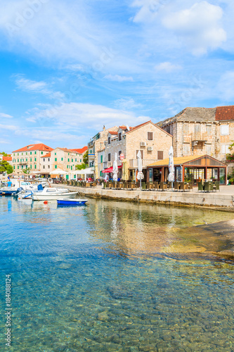 Foto op Canvas Mediterraans Europa POSTIRA VILLAGE, BRAC ISLAND - SEP 7, 2017: Restaurant buildings and houses in Postira port, Brac island, Croatia.