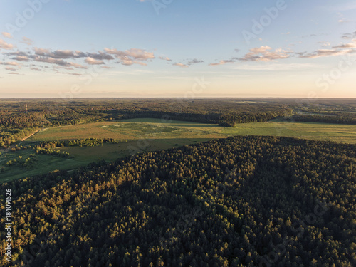 Foto op Canvas Beige Aerial view over Raigardas valley surrounded by pine trees in Svendubre near the border, Lithuania. During summer season sundown.