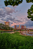 Scioto River and downtown Columbus Ohio skyline at John W. Galbreath Bicentennial Park at dusk - 184098984