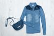 Blue jeans shirt and handbag. Fashionable concept