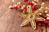 Christmas star on wooden background - 184107139