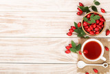 tea with rose hips and honey on a white wooden background with copy space for your text. Top view - 184124144