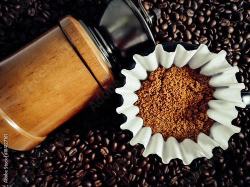 Keuken foto achterwand Koffiebonen coffee bean in a coffee grinder on bean background