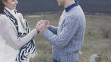 Lovely man warms and kisses woman's hand in windy day. Slowly - 184130567