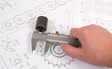 Technical drawing, caliper and driving roller chain. Engineering, technology and metalworking. Caliper measurement of detail of industrial chain. - 184137756