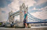Man walking by tower bridge