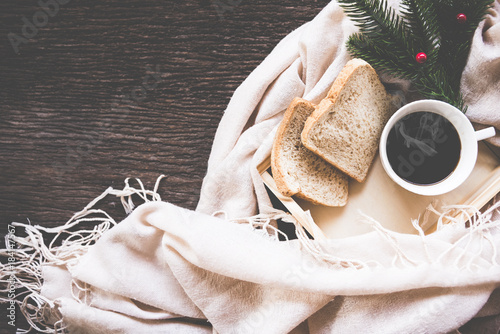 Cup of coffee on rustic wooden serving tray in the cozy bed with blanket. Knitting warm woolen sweater in the winter weekend, top view, vintage tone, Lifestyle Concept. - 184147567