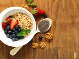 healthy breakfast - granola with fresh berries and nuts, organic food - 184147782