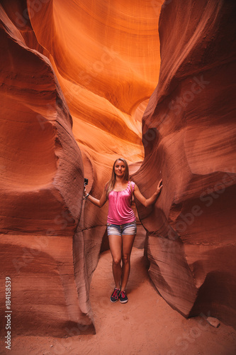 Papiers peints Bordeaux Young girl exploring Antelope Canyon in the Navajo Reservation near Page, Arizona USA