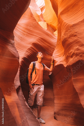 Foto op Canvas Baksteen Young man exploring antelope Canyon in the Navajo Reservation near Page, Arizona USA
