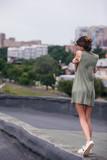 Roof walk pretty girl alone concept. Lack of warmth and care - 184162911