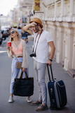tourists tired from a long journey and heavy luggage. family holidays. hot summer day concept - 184163317