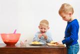 Little boy eating apple for snack - 184164329