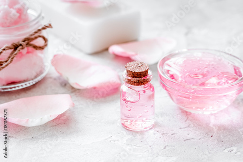 body treatment with rose petals and cosmetic set white desk back