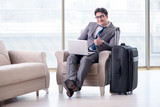 Young businessman in airport business lounge waiting for flight - 184168583
