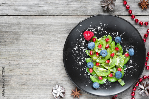 kiwi christmas tree. funny food idea for kids. Christmas and New Year food background