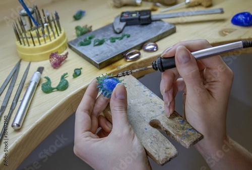 Profession jeweler. Craft jewelery making. working with wax.  © notistia