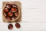 chestnut in bowl on white wooden background with copy space for your text. Top view. Flat lay - 184186701