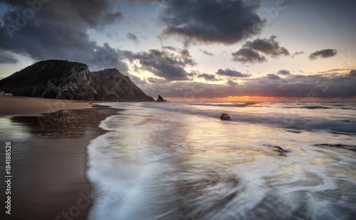 Plexiglas Strand The ocean, one beach and a orange sunset